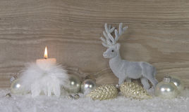 One burning advent candle with deer on wooden brown shabby backg Stock Images
