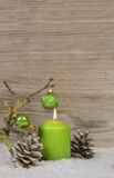 One burning advent candle on an empty wooden background with sno Royalty Free Stock Photo