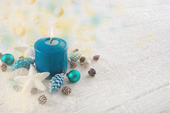 One burning advent candle in turquoise, brown and white colors f Stock Photo