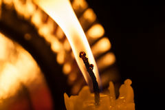 One burning candle in the dark. Macro shot Stock Image