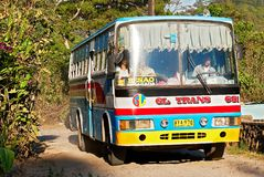 One bus traversing the unpaved road to Besao town stock photography