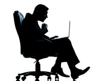 One business man computer computing surprised sitting in armchai Stock Image