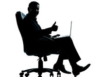 One business man computer thumb up sitting royalty free stock photography