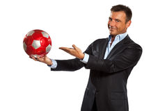 One business man holding showing a soccer ball. One caucasian business man holding showing soccer ball in studio isolated on white background Royalty Free Stock Image