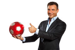One business man holding showing a soccer ball. One caucasian business man holding showing soccer ball in studio isolated on white background Royalty Free Stock Images