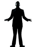 One business man hopeful looking up silhouette. One caucasian business man hopeful looking up silhouette standing Full length in studio isolated on white stock photography