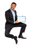 One business man jumping holding showing whiteboard Stock Photography
