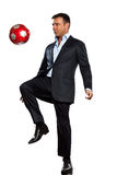 One business man playing juggling soccer ball. One caucasian business man playing juggling soccer ball in studio isolated on white background Royalty Free Stock Photos