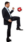 One business man playing juggling soccer ball Royalty Free Stock Image