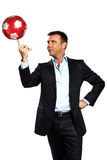 One business man playing juggling soccer ball. One caucasian business man playing juggling soccer ball in studio isolated on white background Stock Image