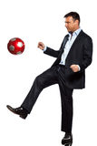 One business man playing juggling soccer ball. One caucasian business man playing juggling soccer ball in studio isolated on white background Stock Photos