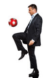 One business man playing juggling soccer ball. One caucasian business man playing juggling soccer ball in studio isolated on white background Stock Images