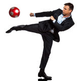 One business man playing kicking soccer ball. One caucasian business man playing kicking soccer ball in studio isolated on white background Stock Photography