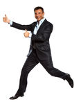 One business man running jumping double thumbs up Stock Photo