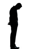 One business man sad lonely silhouette. One caucasian business man sad lonely silhouette standing Full length in studio isolated on white background royalty free stock image