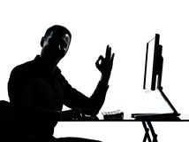 One business man silhouette computer computing ok gesture Royalty Free Stock Photography