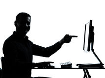 One business man silhouette computer  pointing Royalty Free Stock Images
