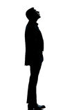 One business man silhouette looking up Stock Photos