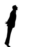 One business man silhouette tiptoe looking up. One caucasian business man silhouette standing tiptoe looking up Full length in studio isolated on white Stock Images