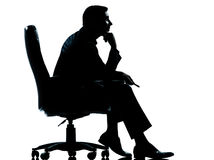 One business man sitting in armchair silhouette Stock Images