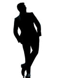 One business man standing Full length hands pocket. One caucasian business man silhouette standing Full length hands in pocket in studio isolated on white royalty free stock photography