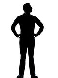 One business man standing hands on hips silhouette Stock Images