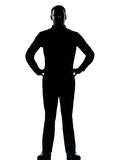 One business man standing hands on hips silhouette Royalty Free Stock Photography