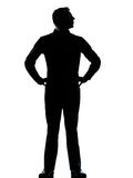 One business man standing hands on hips silhouette Stock Image