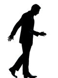 One business man walking looking down silhouette Royalty Free Stock Image