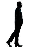 One business man walking silhouette Royalty Free Stock Photos