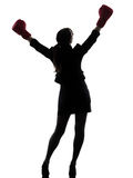Business woman boxing gloves silhouette Stock Photo