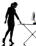 Business woman igniting computer computing  silhouette Royalty Free Stock Photography