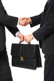 One businessman gives another briefcase Stock Image