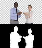 One businessman and one businesswoman applauding, Alpha Channel royalty free stock photography