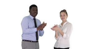 One businessman and one businesswoman applauding on white background. Medium shot. One businessman and one businesswoman applauding on white background stock footage