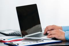 One businessman typing to check the data of  the sale volume report. From laptop on white background Stock Photography