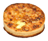 Buttered Crumpet. One buttered crumpet isolated on a white background Stock Photos