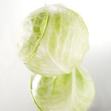 One cabbage on the mirror. One fresh cabbage on the mirror stock photos