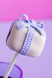 One cake pop. A purple cakepop with a bow Stock Images