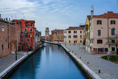 One of the canals in Venice and the Arsenal Tower Royalty Free Stock Image