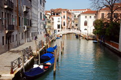 One of the canals in Venice, ols buildings and typical bridge. Italy Stock Image