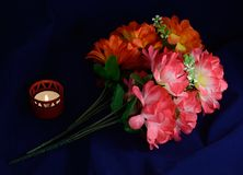 One candle artificial flowers Stock Image