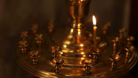 One candle is burn in the Orthodox Church. stock video footage