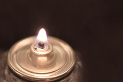 One candle flame on dark background Royalty Free Stock Images