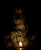 One candle flame at night with bokeh Stock Photos