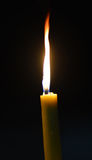 One candle flame at night closeup - . Royalty Free Stock Photography