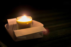 One candle flame at night closeup Royalty Free Stock Photography