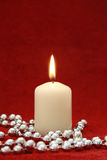 One candle on red velvet background Royalty Free Stock Photography