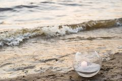 One candle at the sea. Spa theme Royalty Free Stock Image