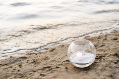 One candle at the sea. Spa theme Stock Photography